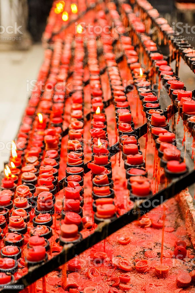 red candles in row-cebu stock photo