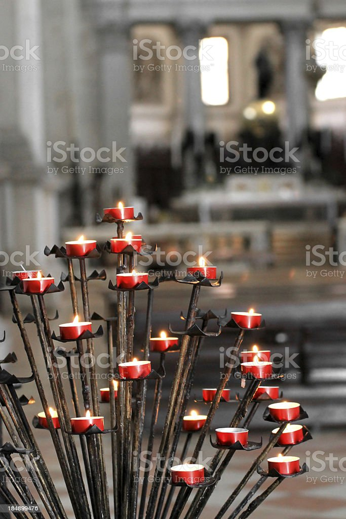 Red candles inside a church royalty-free stock photo