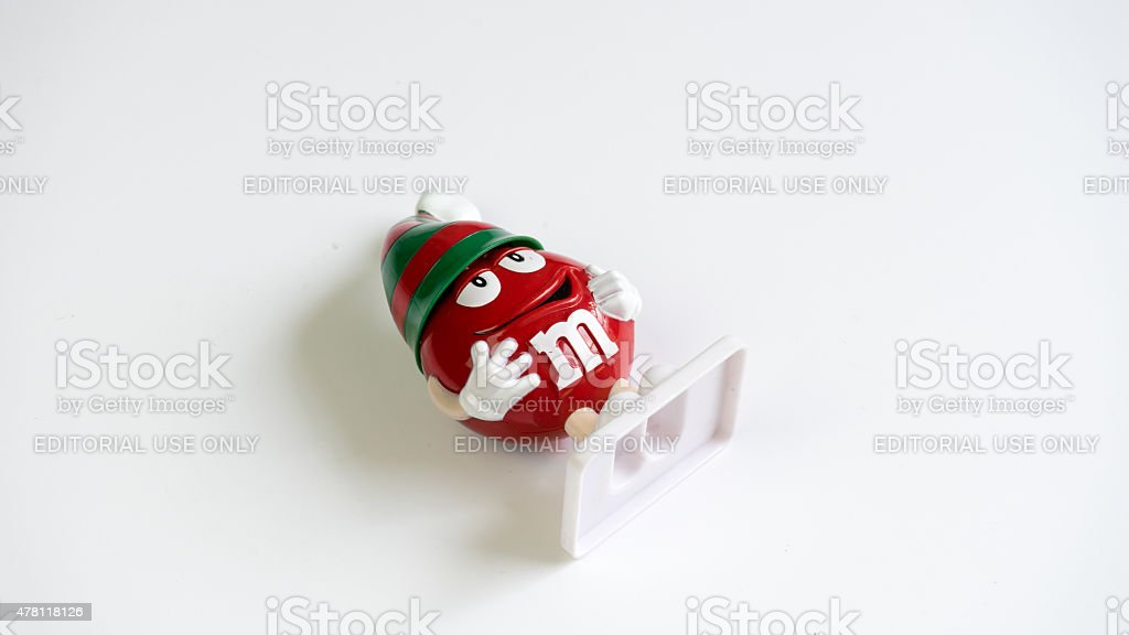 M&M red candy figure wearing Christmas hat stock photo