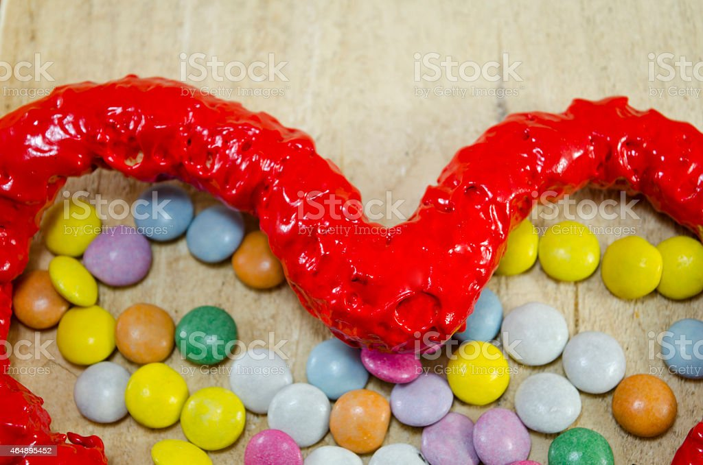 Red candy heart and colorful candy bombons royalty-free stock photo