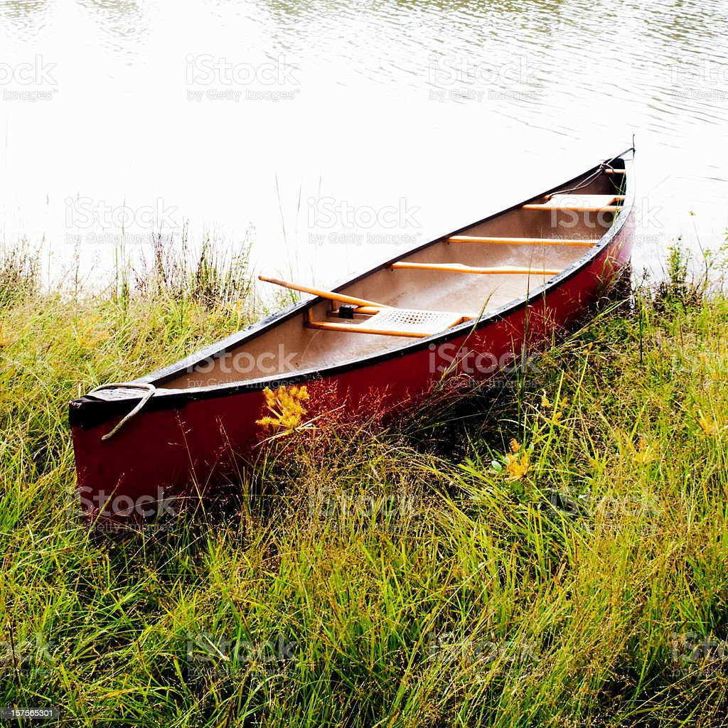 Red Canoe by Lake stock photo