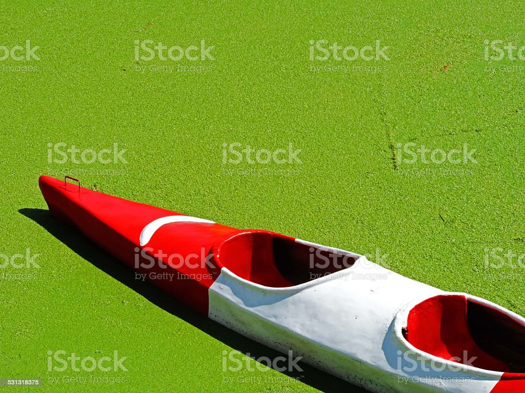 Red canoe in Lake Titicaca stock photo