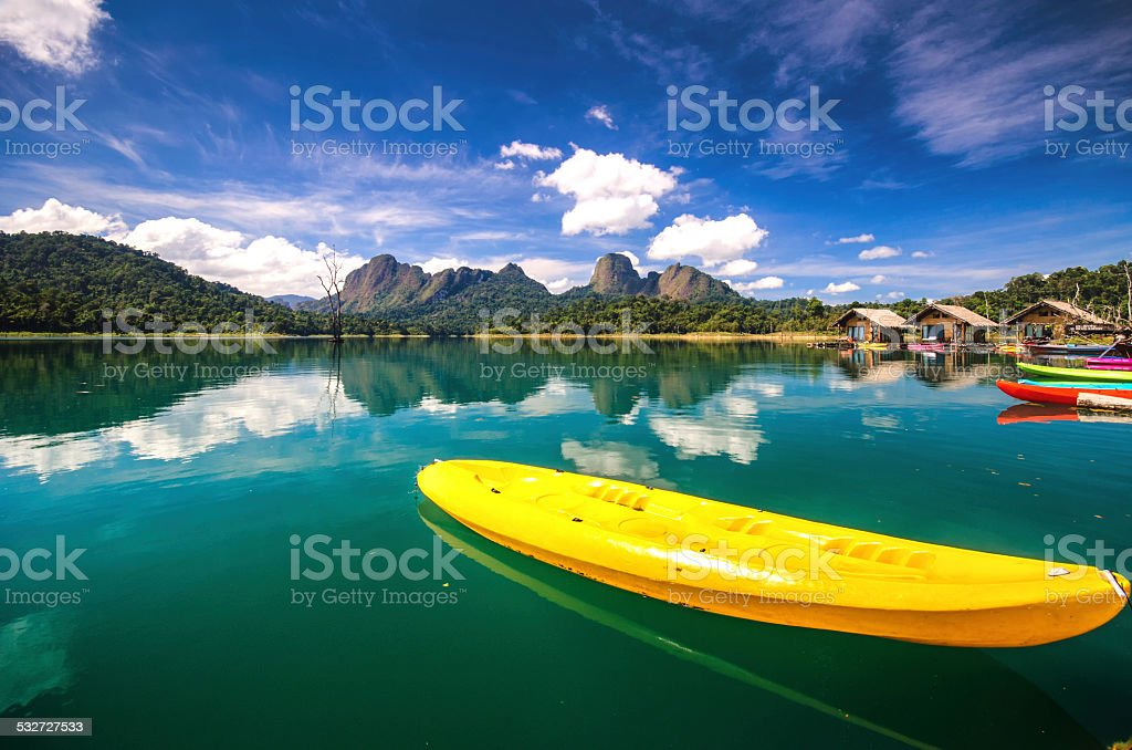 red canoe in ratchaprapa dam stock photo