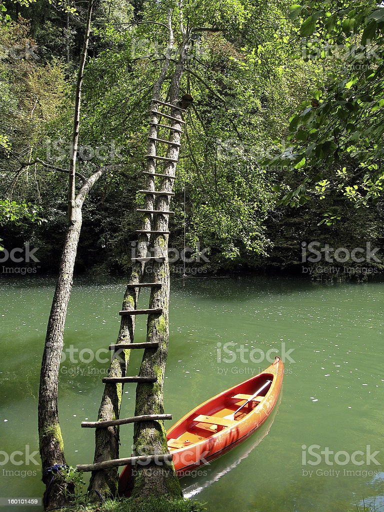 Red canoe in river Krka-Slovenia royalty-free stock photo