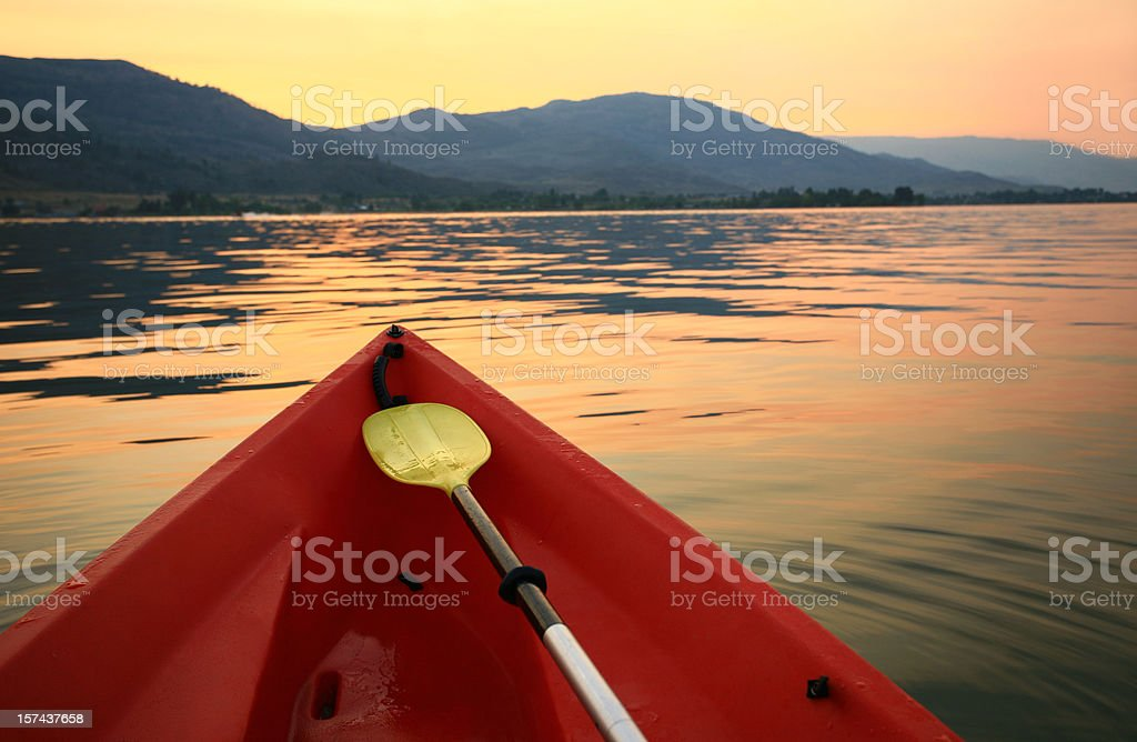 Red Canoe on a Beautiful Mountain Lake royalty-free stock photo