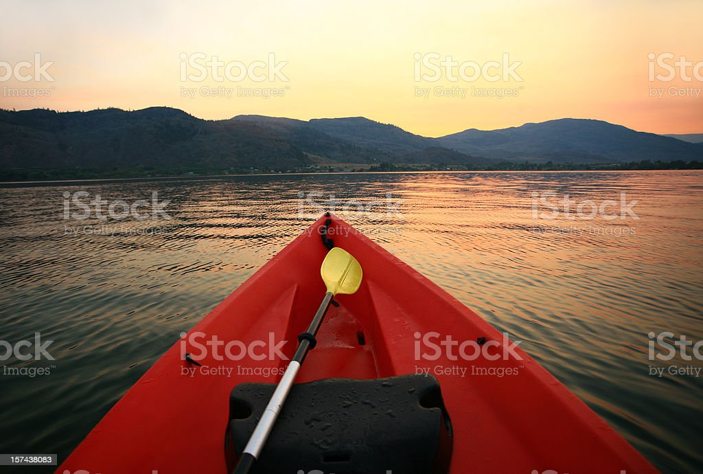Red Canoe on a Mountain Lake royalty-free stock photo