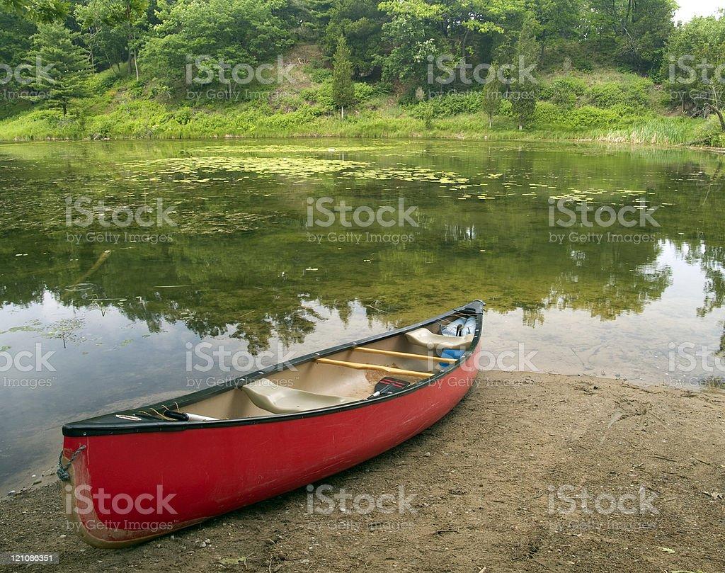 Red Canoe on Shore royalty-free stock photo