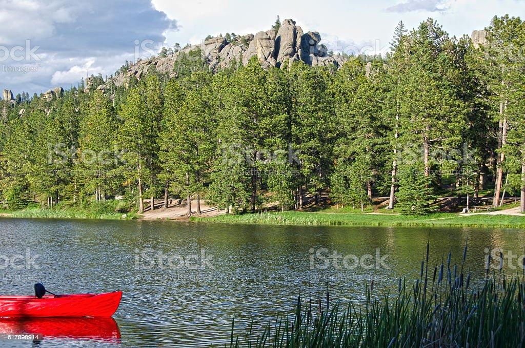 Red Canoe on Sylvan Lake stock photo