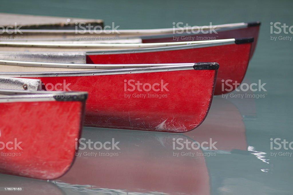 Red Canoes on Beautiful Lake stock photo
