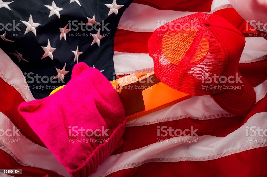 Red cap, conservative, traditionalist, establishment vs pussyhat, liberal, progressive, resistance stock photo