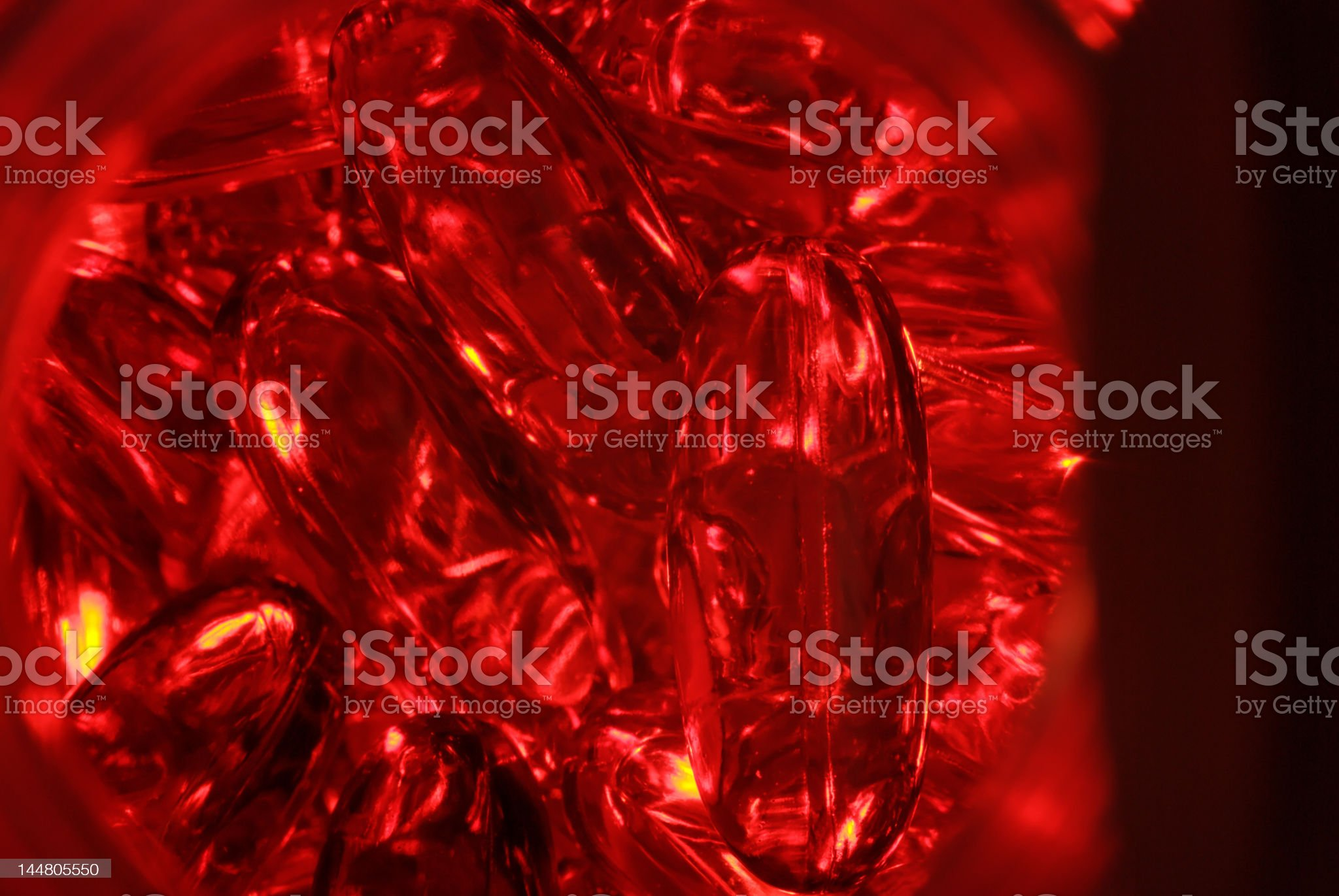 Red Capsules in a Jar royalty-free stock photo
