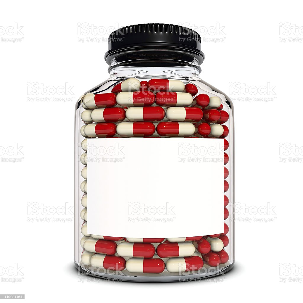 Red capsules into the glass bottle royalty-free stock photo