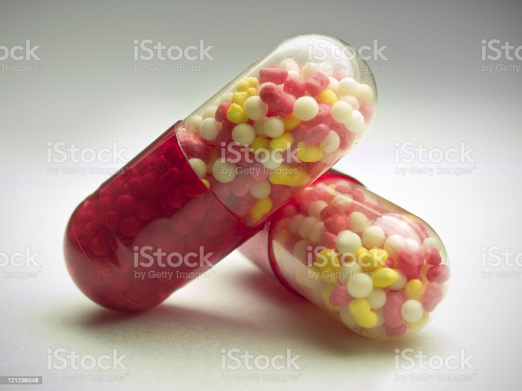 red capsules over gray royalty-free stock photo