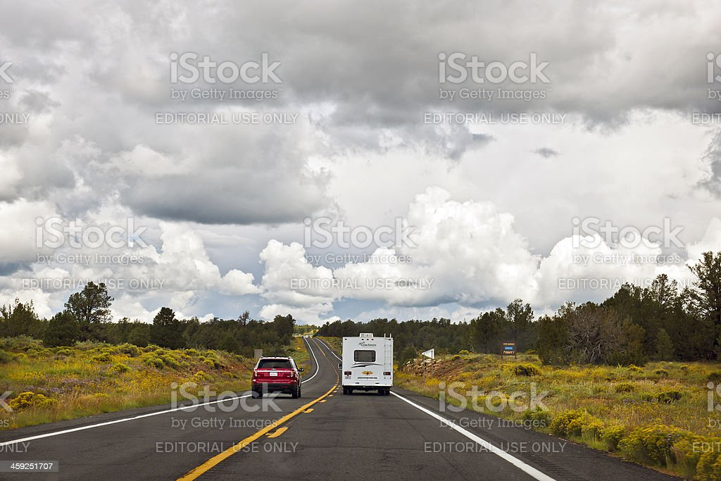 Red Car and RV Driving towards Grand Canyon Arizona USA royalty-free stock photo