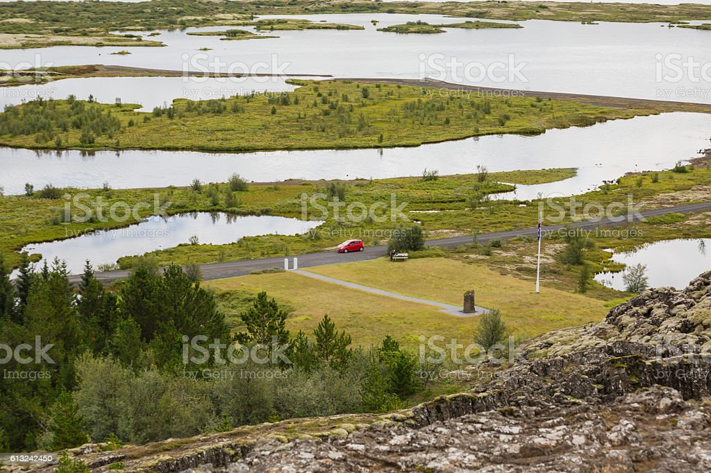Red car at Thingvellir National Park, Iceland stock photo