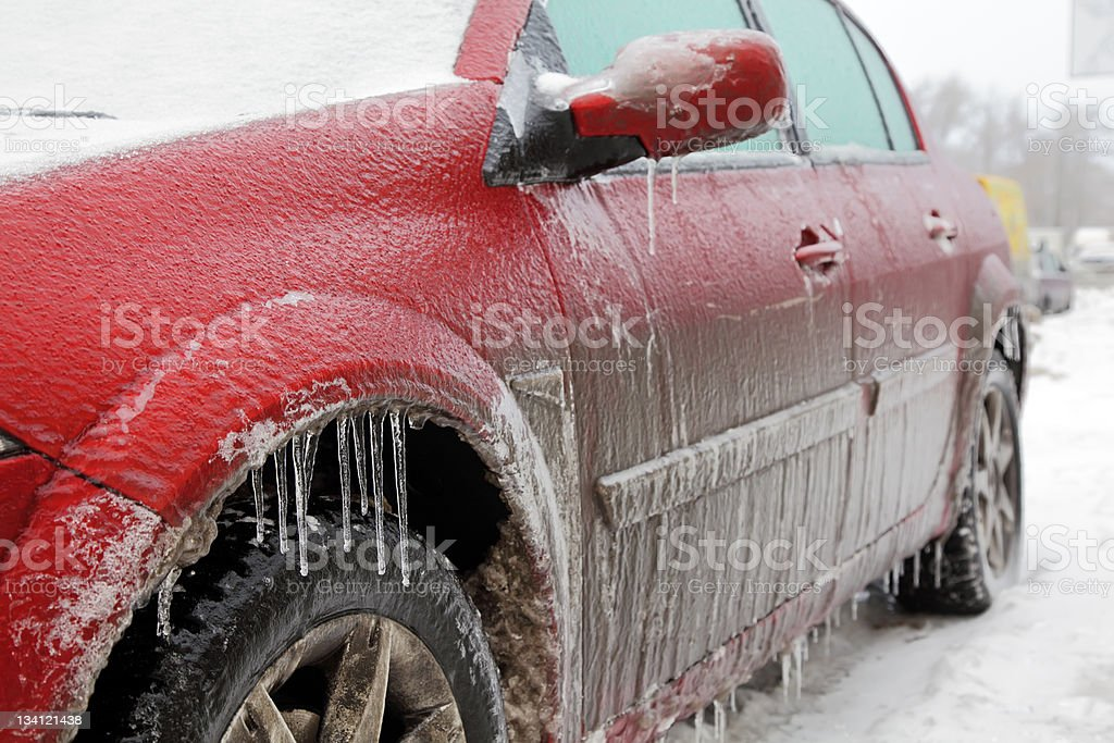 Red car covered in ice. royalty-free stock photo
