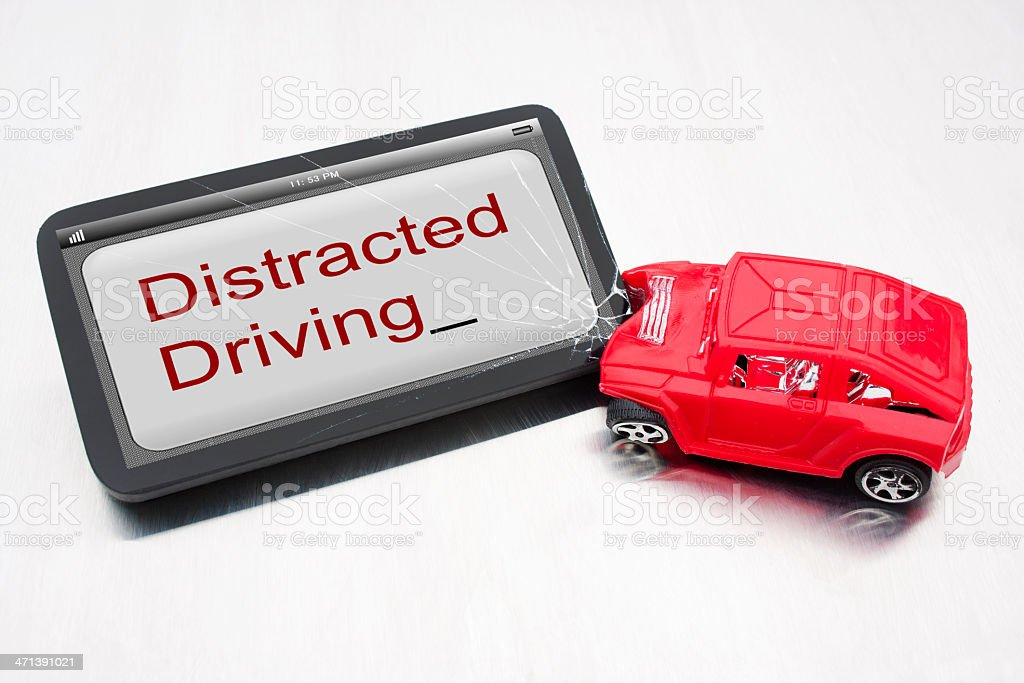 Red car crashing into distracted driving sign royalty-free stock photo