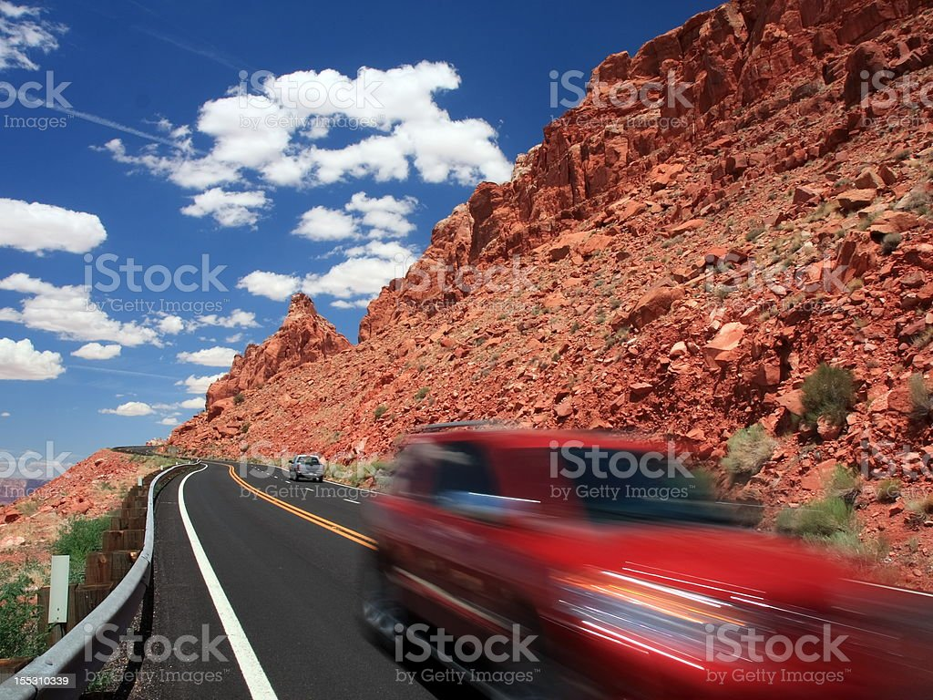 Red car moving on the road stock photo