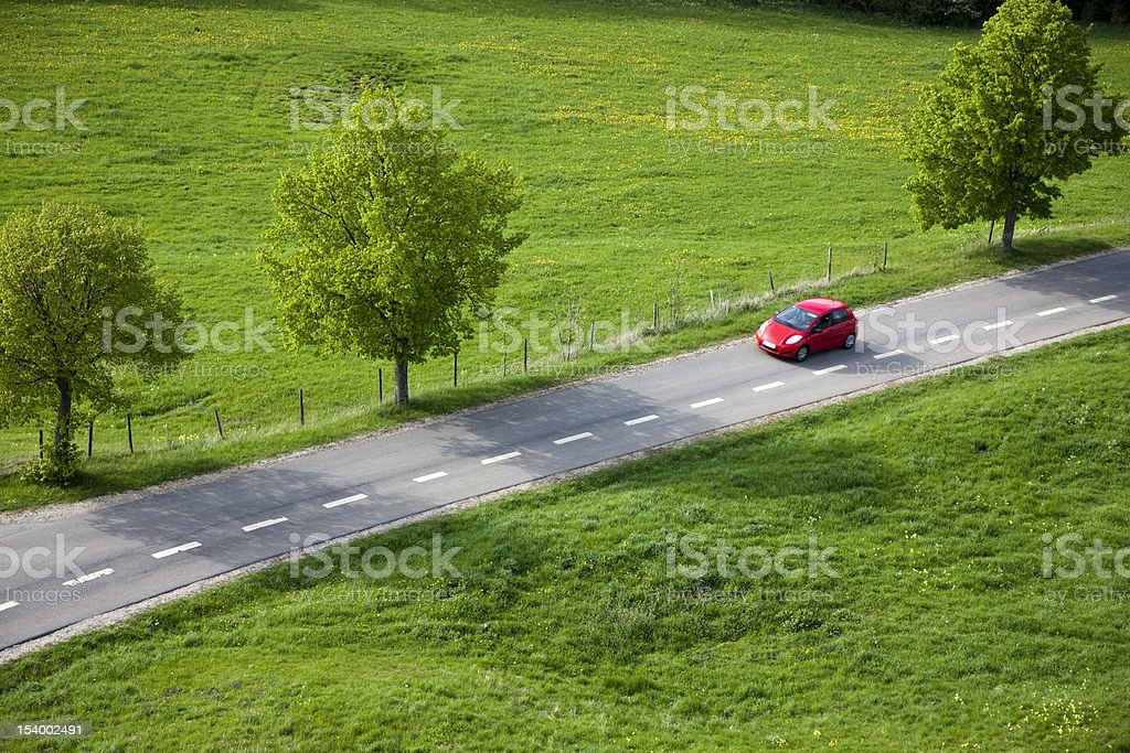Red Car on Country Road, Spring, Aerial View stock photo