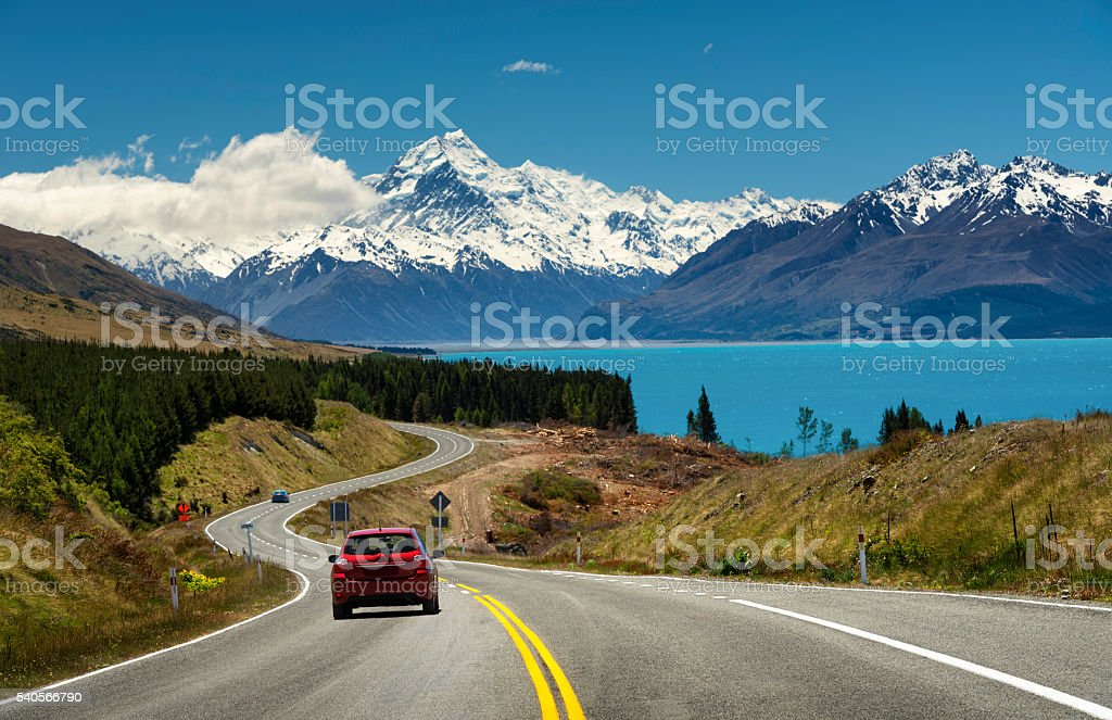 Red car on the road to Mt.Cook,New Zealand stock photo