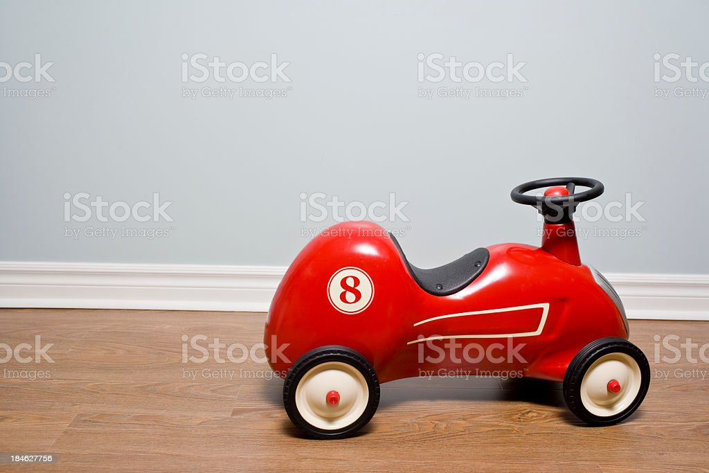 Red Car vintage toy car on a hardwood floor stock photo