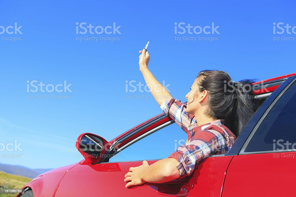 Red Car Woman - Holding Key royalty-free stock photo