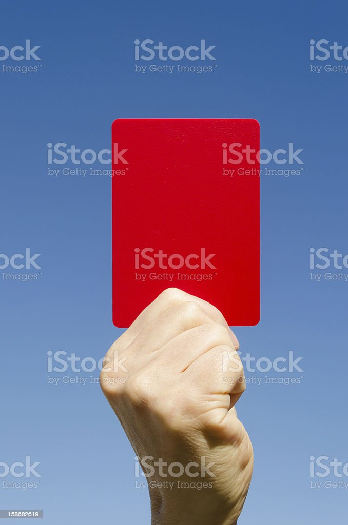 Red card in the hand again blue sky stock photo