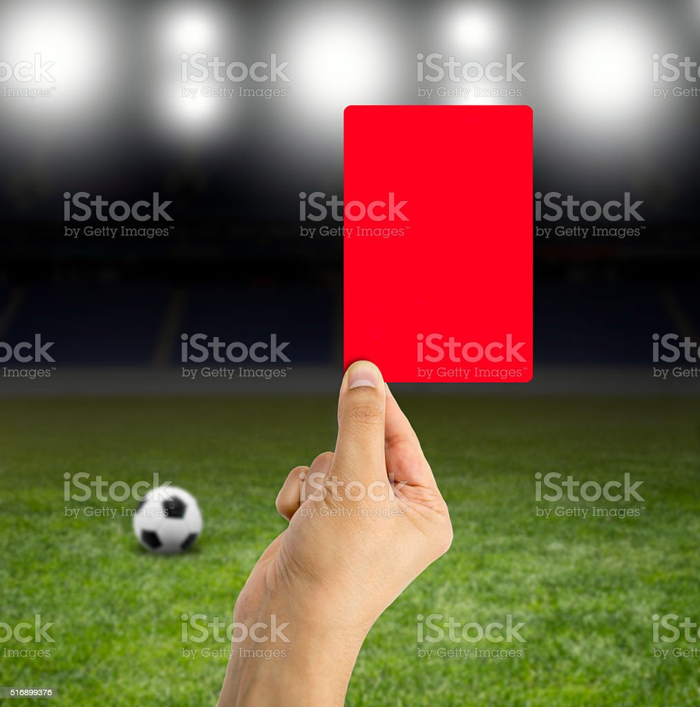 red card in the spotlight stock photo