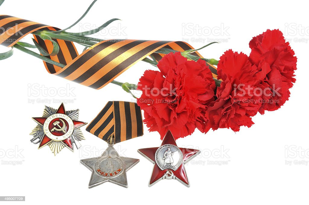 Red carnations tied with Saint George ribbon and orders stock photo