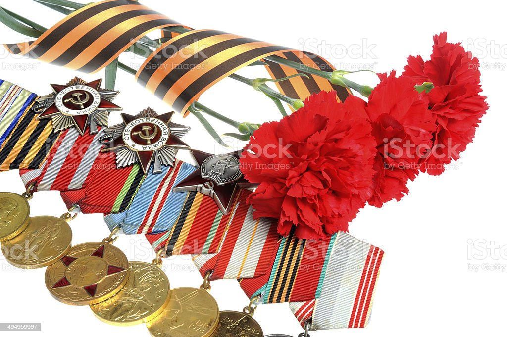 Red carnations with Saint George ribbon and medals stock photo