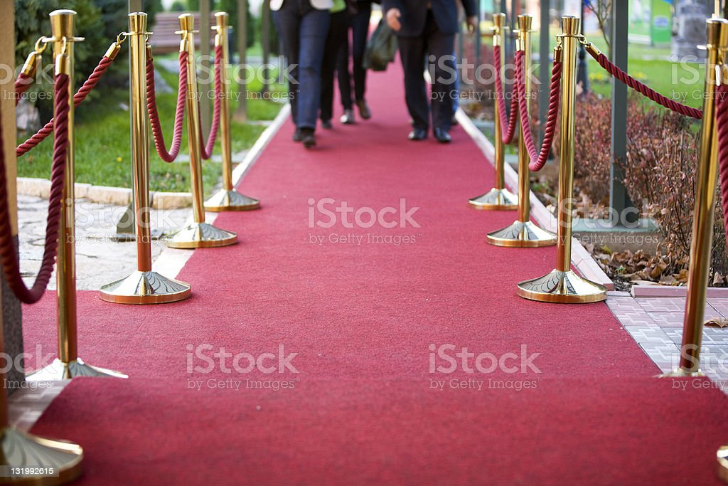 Red carpet and stanchions stock photo