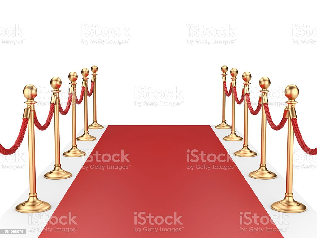 red carpet between two gold stanchions with rope stock photo