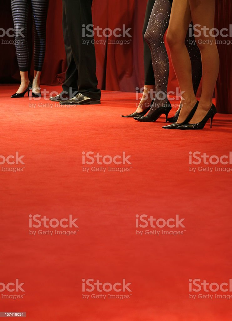 Red carpet catwalk with fashion models legs stock photo