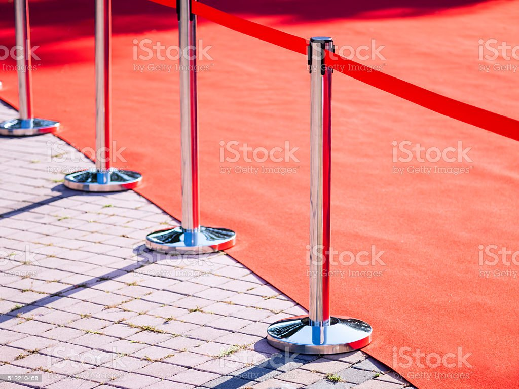 Red Carpet fence pole with red ropes Fashion show event stock photo