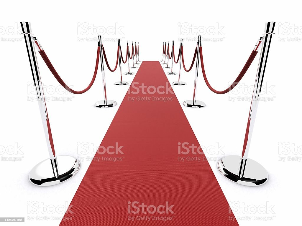 A red carpet laid out with separation poles royalty-free stock photo