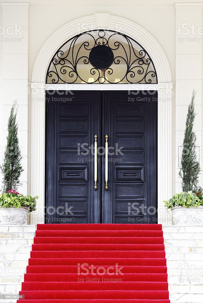 Red carpet leading to the door stock photo