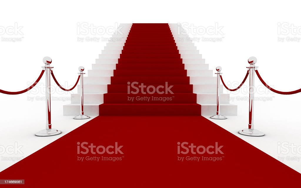 Red carpet leading to white stairs stock photo