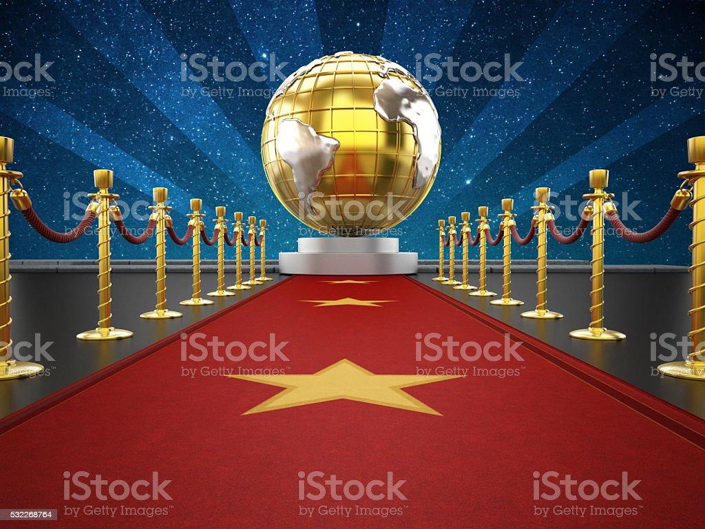 Red carpet, velvet ropes and golden earth model stock photo