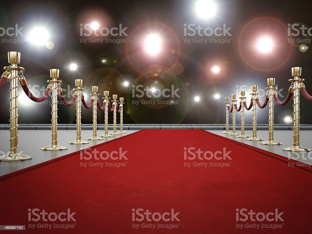Red carpet with camera flashlights on the background stock photo