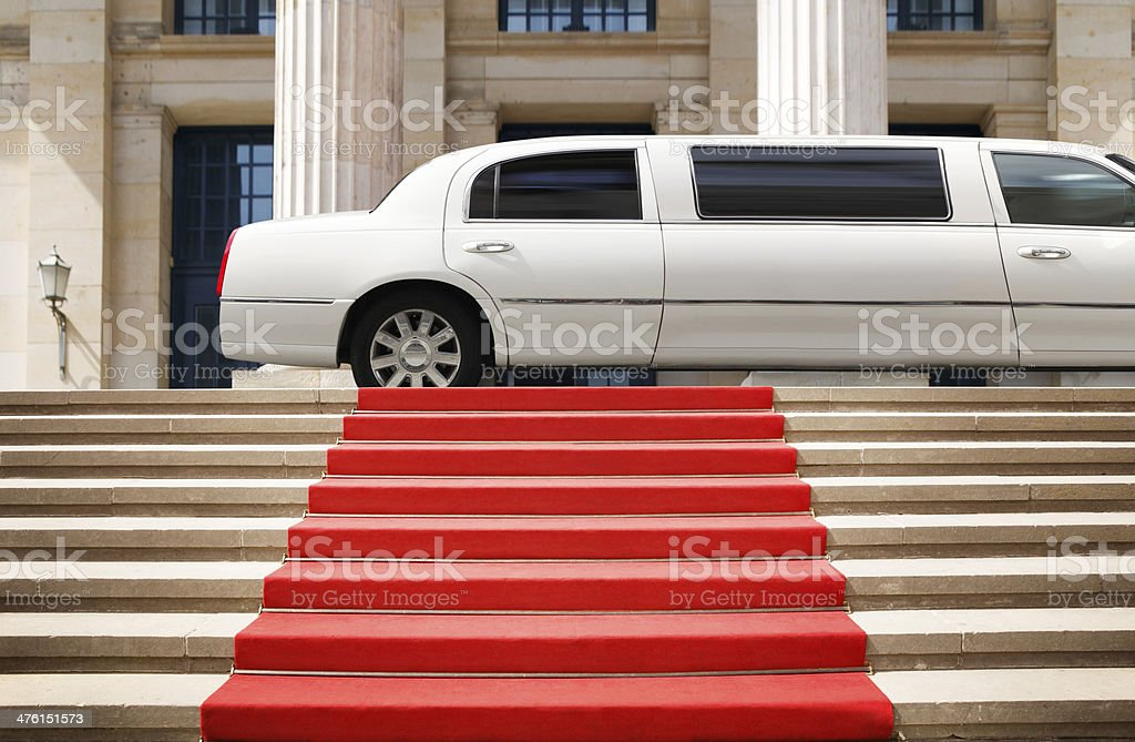 Red carpet with limousine ready for celebrity stock photo