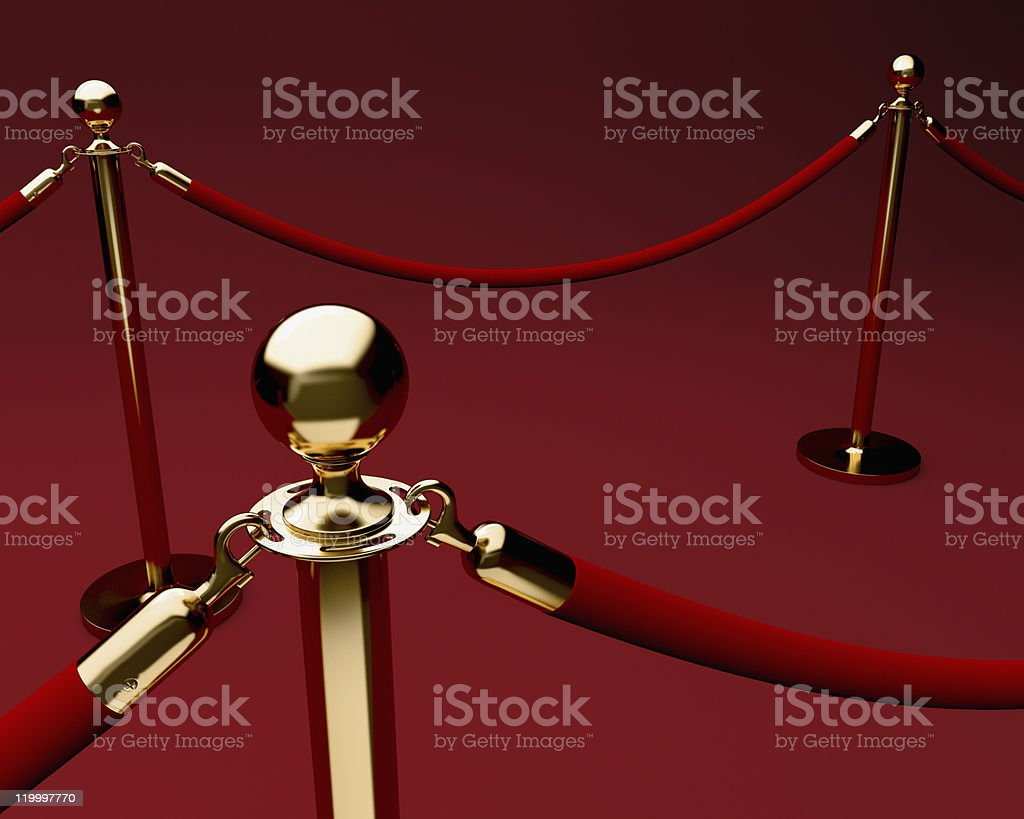 Red carpet with velvet rope and stanchions. stock photo