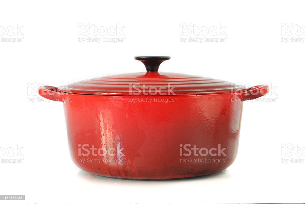 Red casserole dish on white background stock photo
