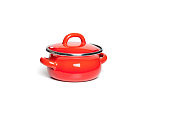 Red cast iron cooking pot, isolated on white background.