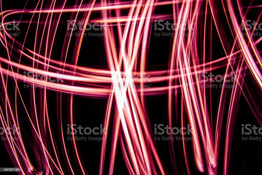 Red Caution Abstract Intersections Neon Light Black Background Screesaver stock photo