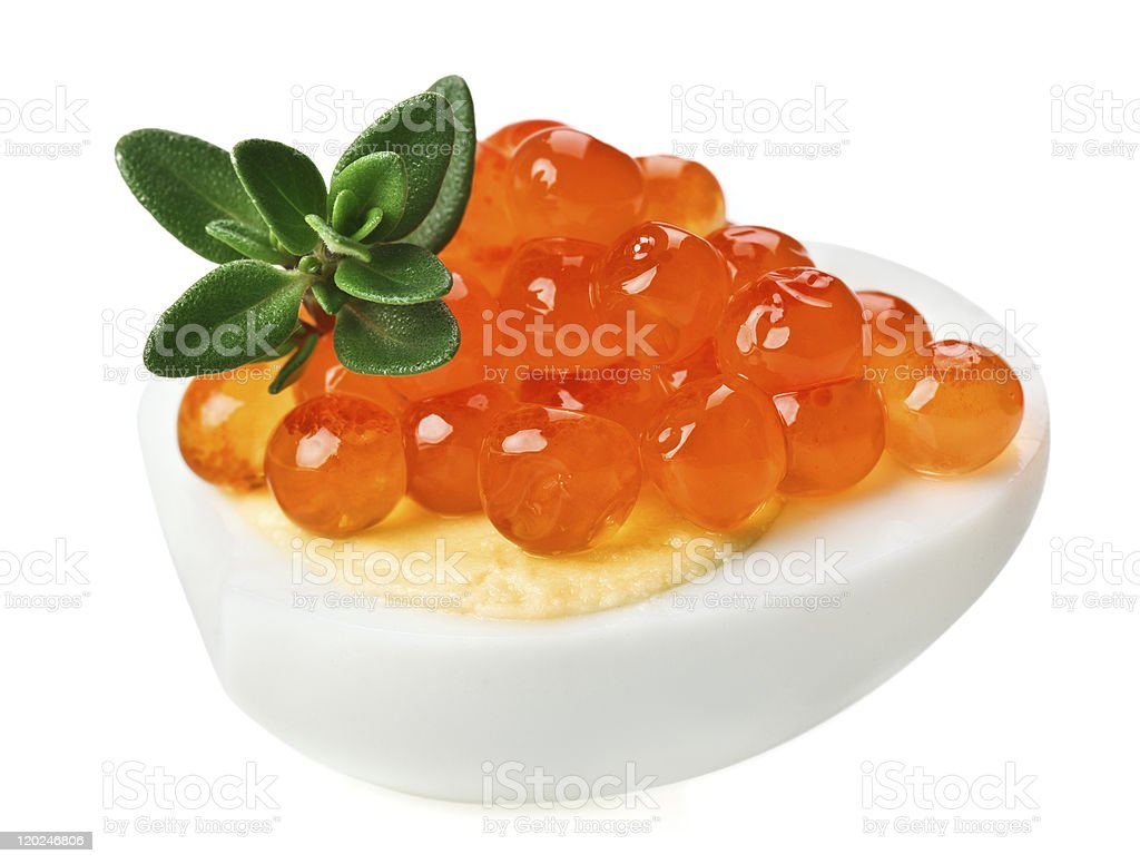 Red caviar canape with quail egg and thyme twig royalty-free stock photo