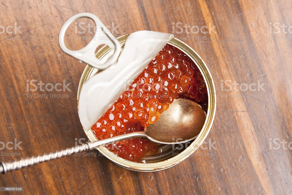 red caviar in bank with spoon on wood royalty-free stock photo