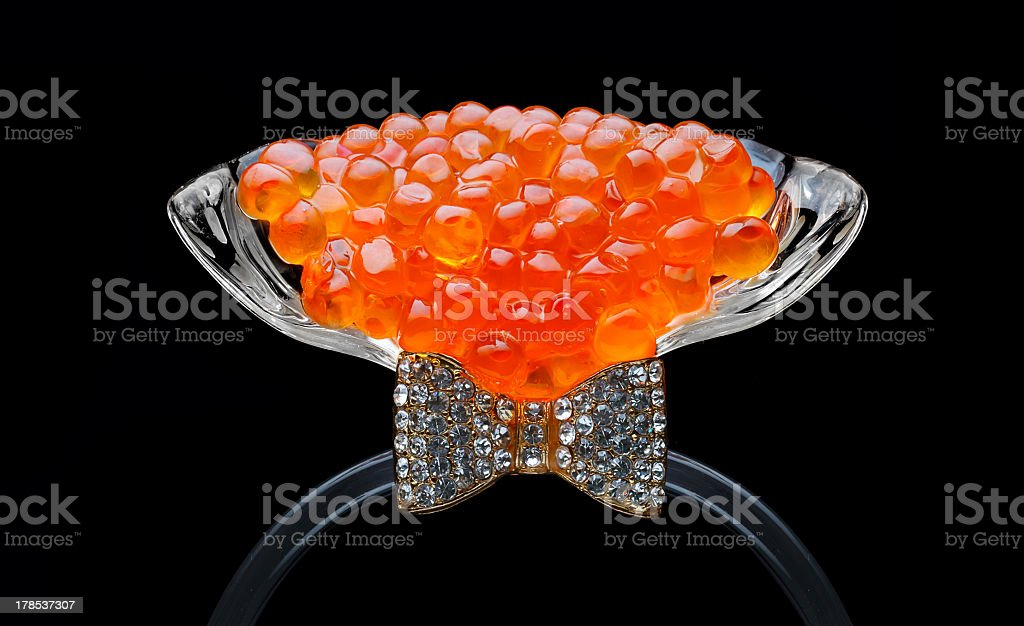 Red caviar in glass isolated on black royalty-free stock photo