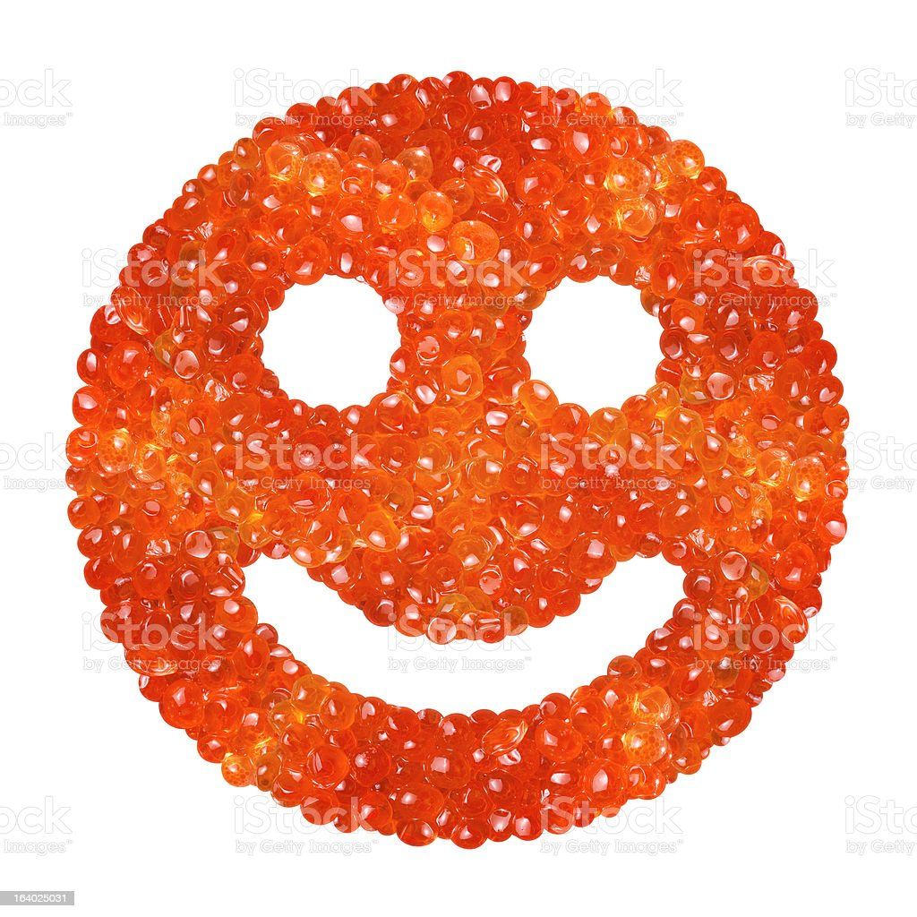 Red caviar in the form of a smile royalty-free stock photo