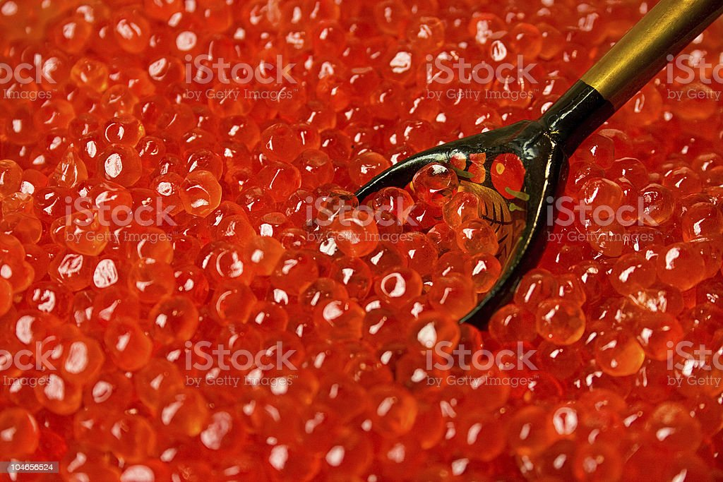 red caviar in wooden spoon royalty-free stock photo
