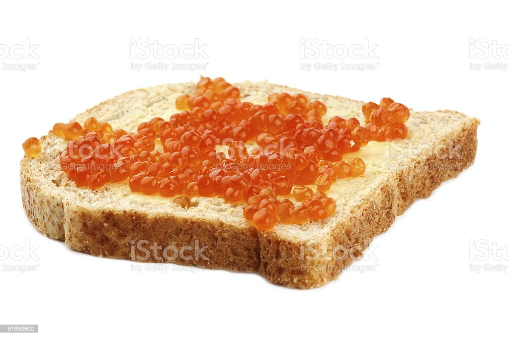 red caviar on Brown Sliced Bread with butter royalty-free stock photo